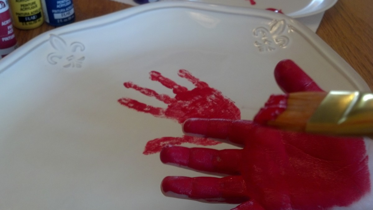 Paint your child's entire hand with ceramic paint and press firmly to platter.