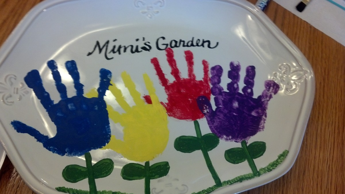 "Using a black ceramic marker, I wrote out ""Mimi's Garden"" above the flowers."