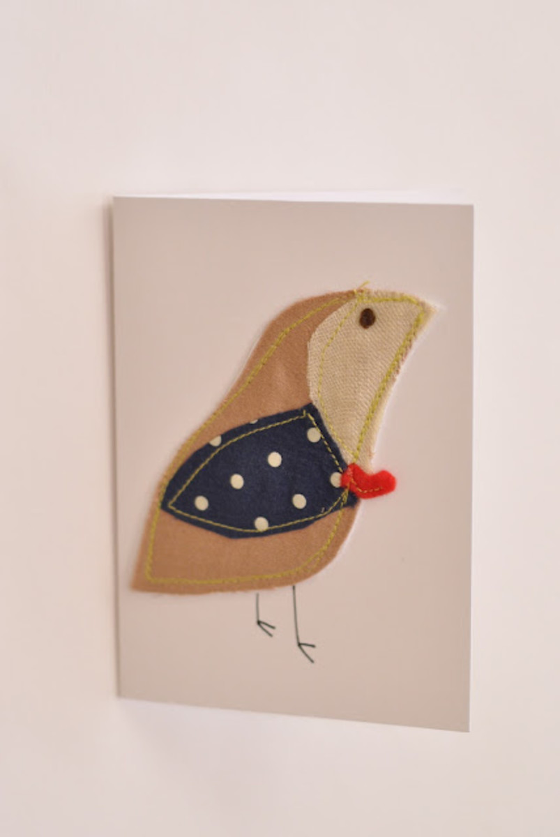Ashley sewed fabric scraps on greeting cards.