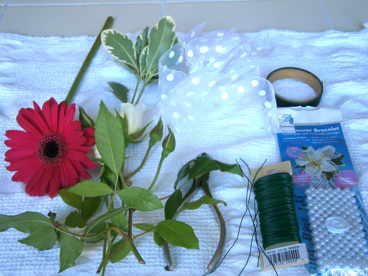 From left to right: flowers of choice, ribbon, wire cutter, floral wire, floral tape and flower bracelet.