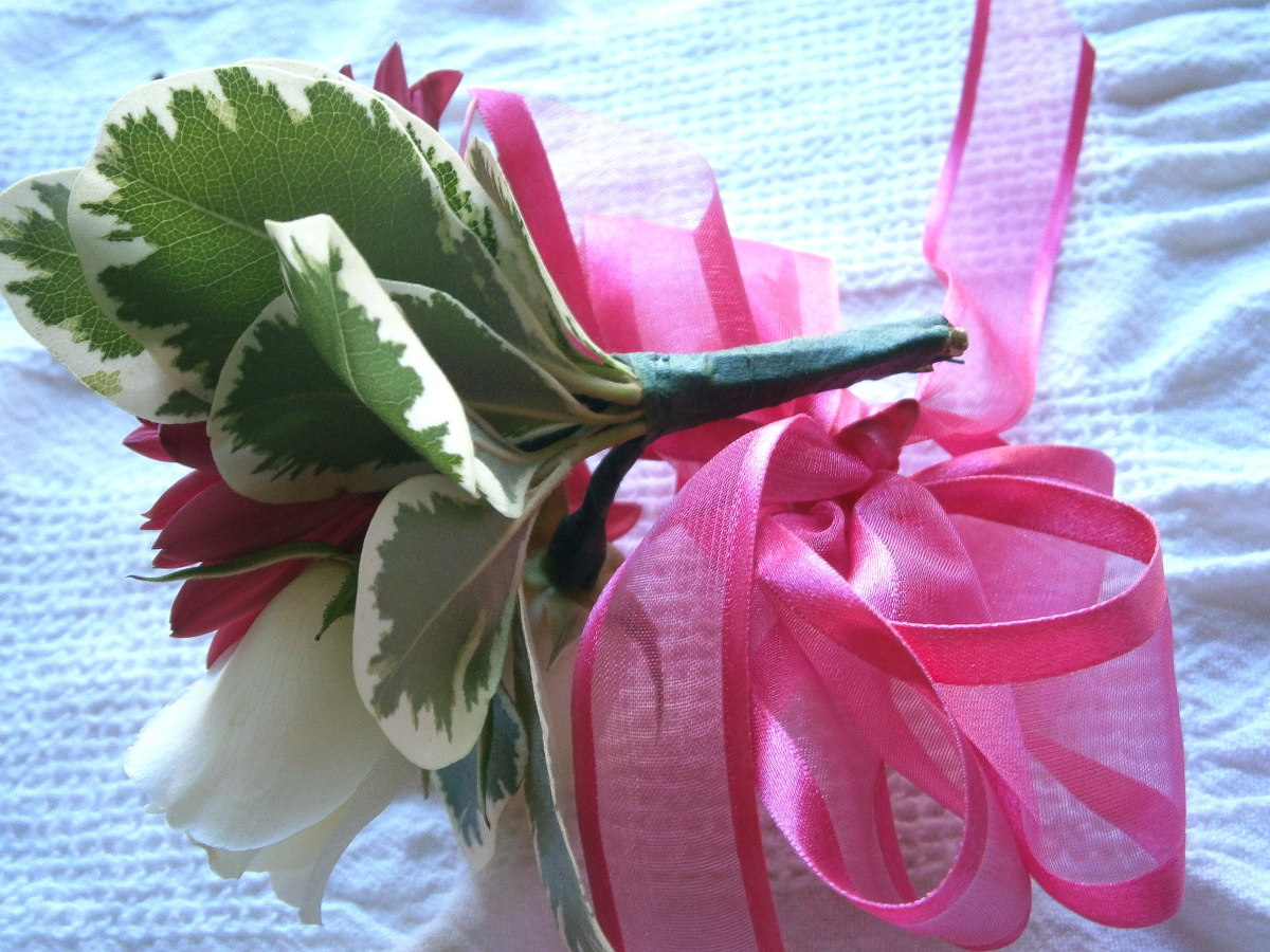 Light ribbon is a better choice as you don't want the corsage to weigh a ton.