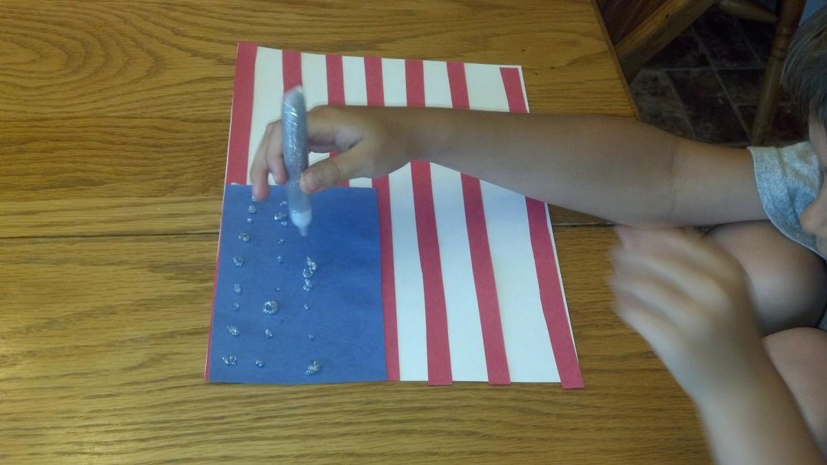 Make 50 stars with silver glitter glue.