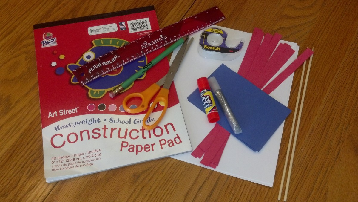 Supplies to make a paper flag.