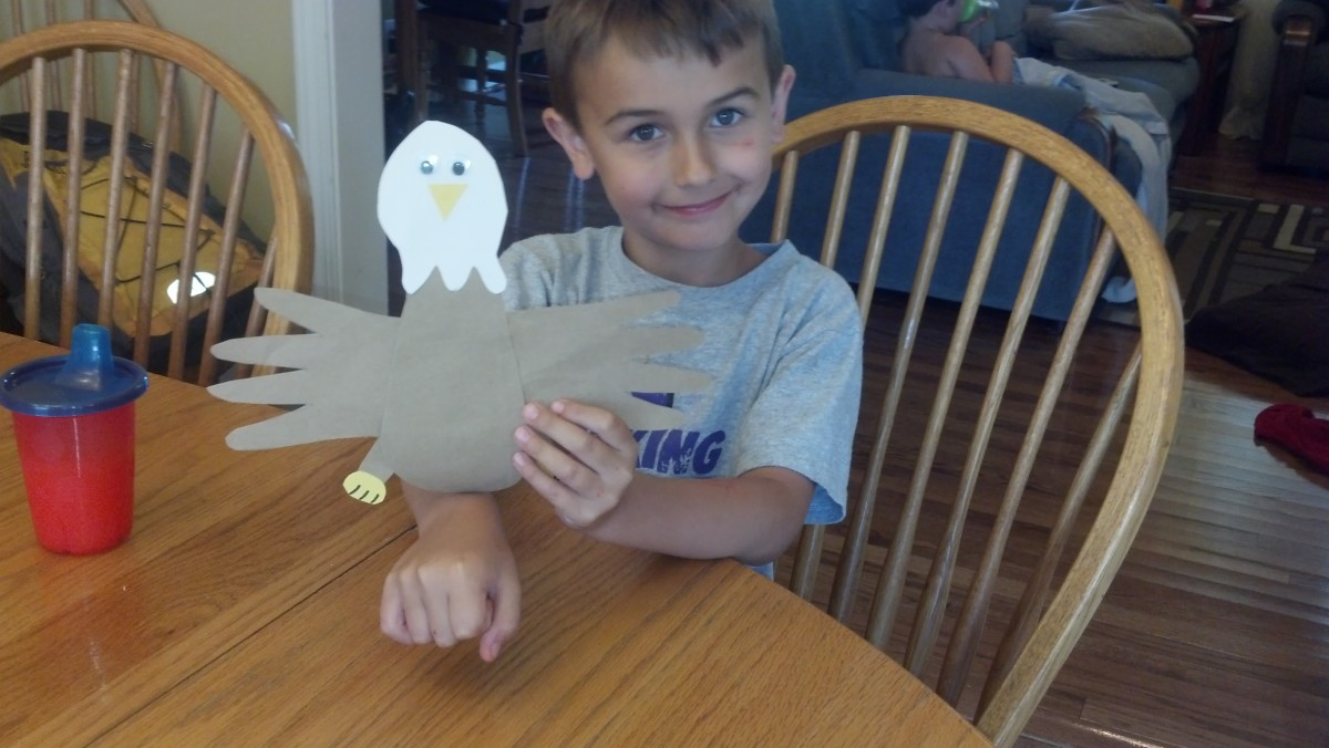 My son proudly displaying his handprint eagle.