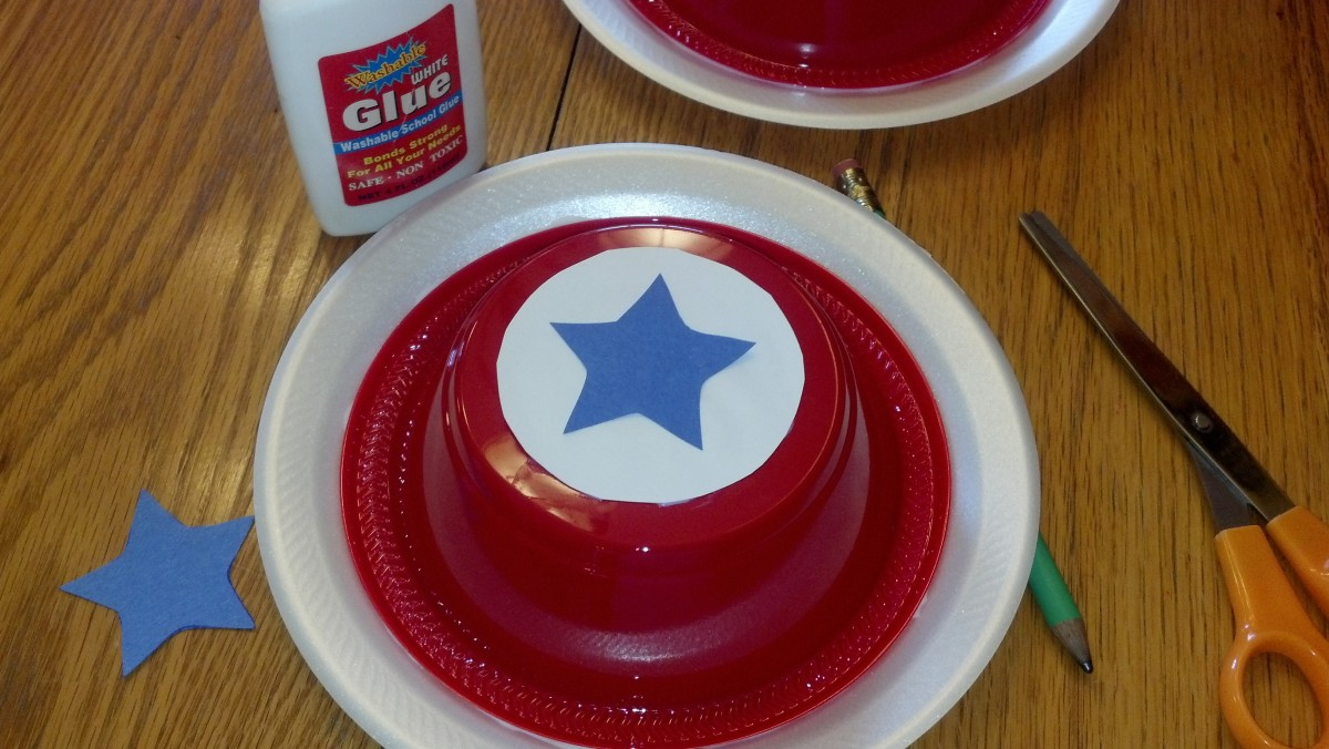 Glue on white circle and blue star to top of bowl.