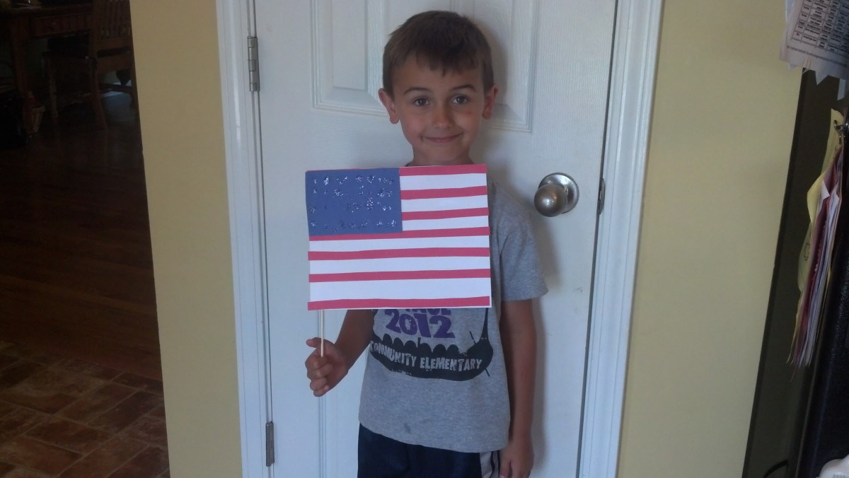 My son proudly holding his flag.