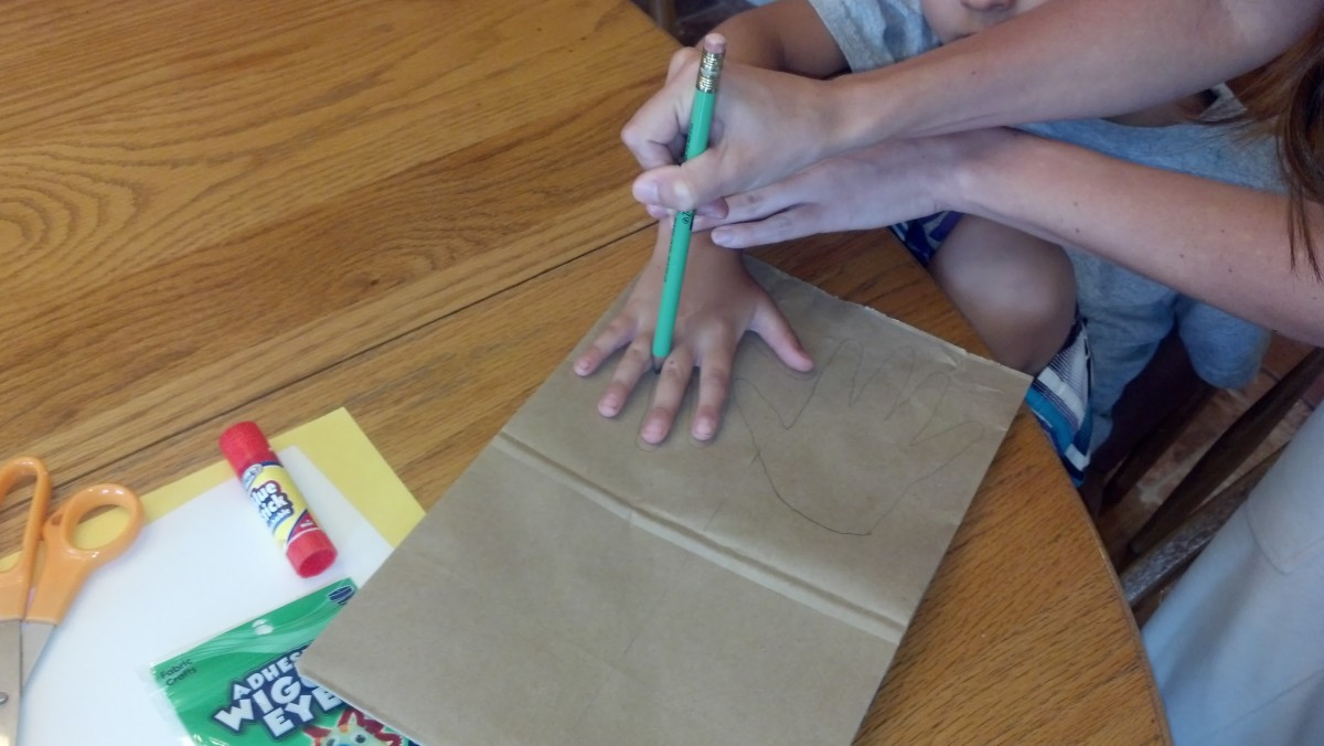 Outline your child's handprints on a brown paper bag.