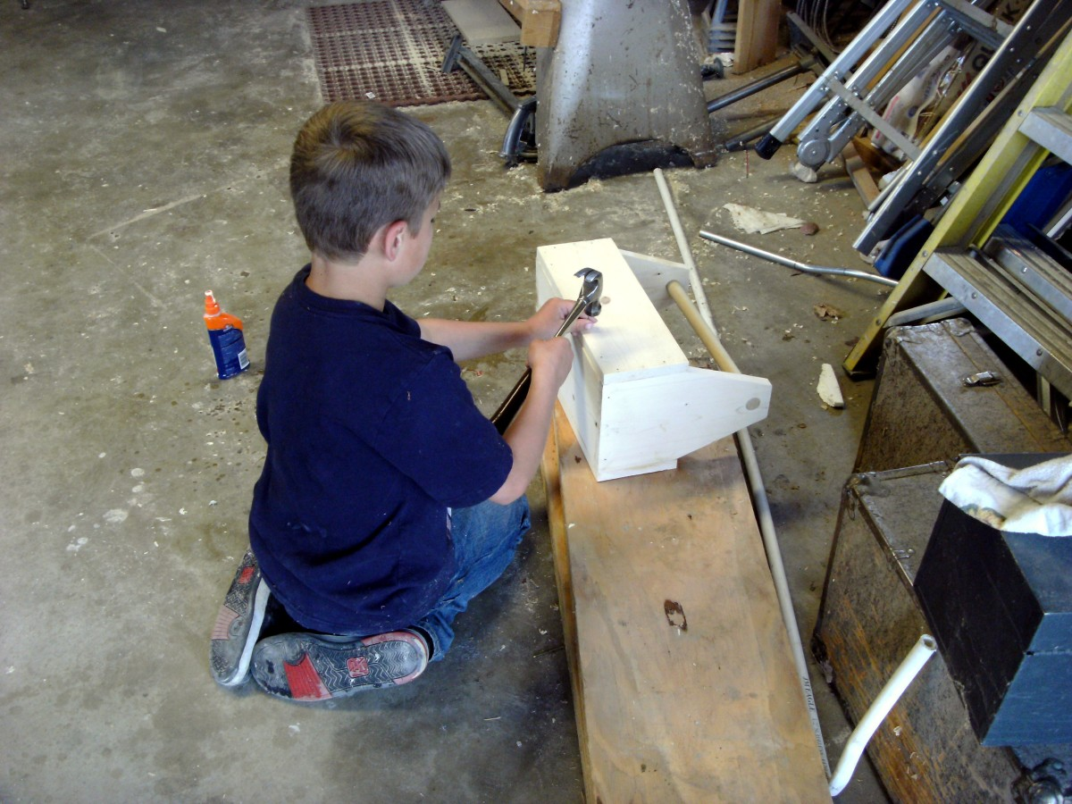 Nailing the toolbox together.  Small finish nails were not easy for a novice and there were some goofs, but the job got done.