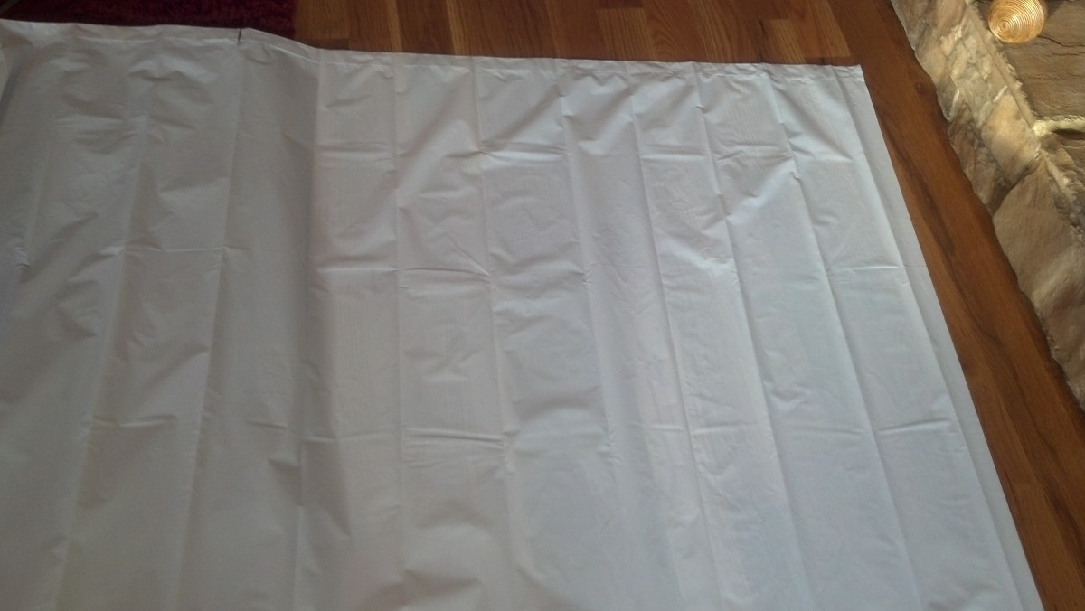 Measure and cut a shower curtain to fit the mast of the raft.