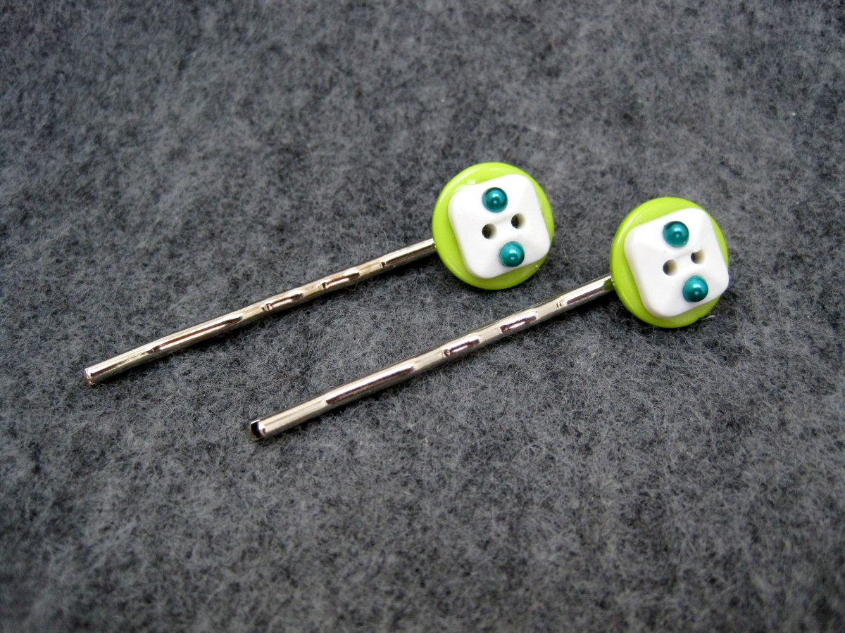 I added self adhesive rhinestones to this pair of button hair pins.