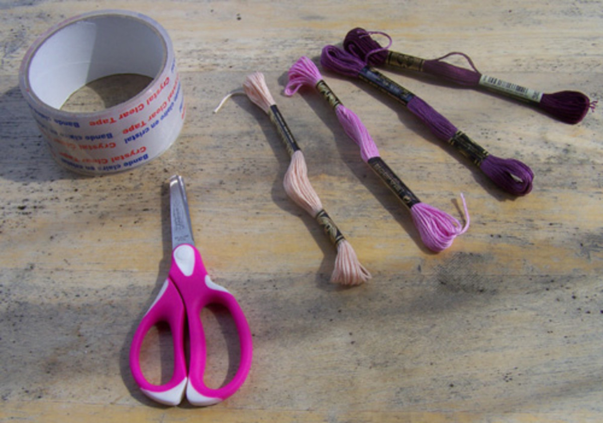You will need embroidery floss, scissors and tape.