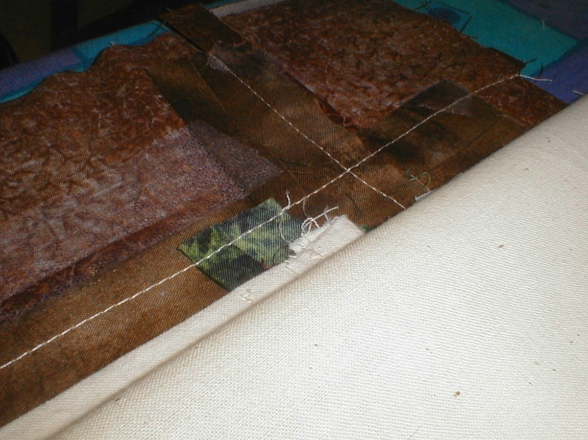 Laying the protective layer of calico on the back of the frame.