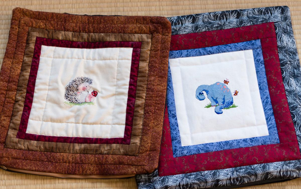 Finished cross stitch pillows.