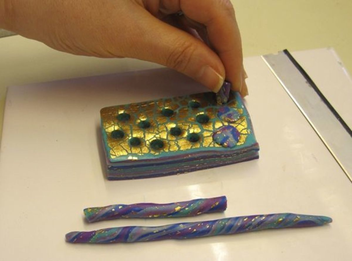 Plugging holes in a polymer clay mokume stack with snakes make from the optional trimmings from Step 3