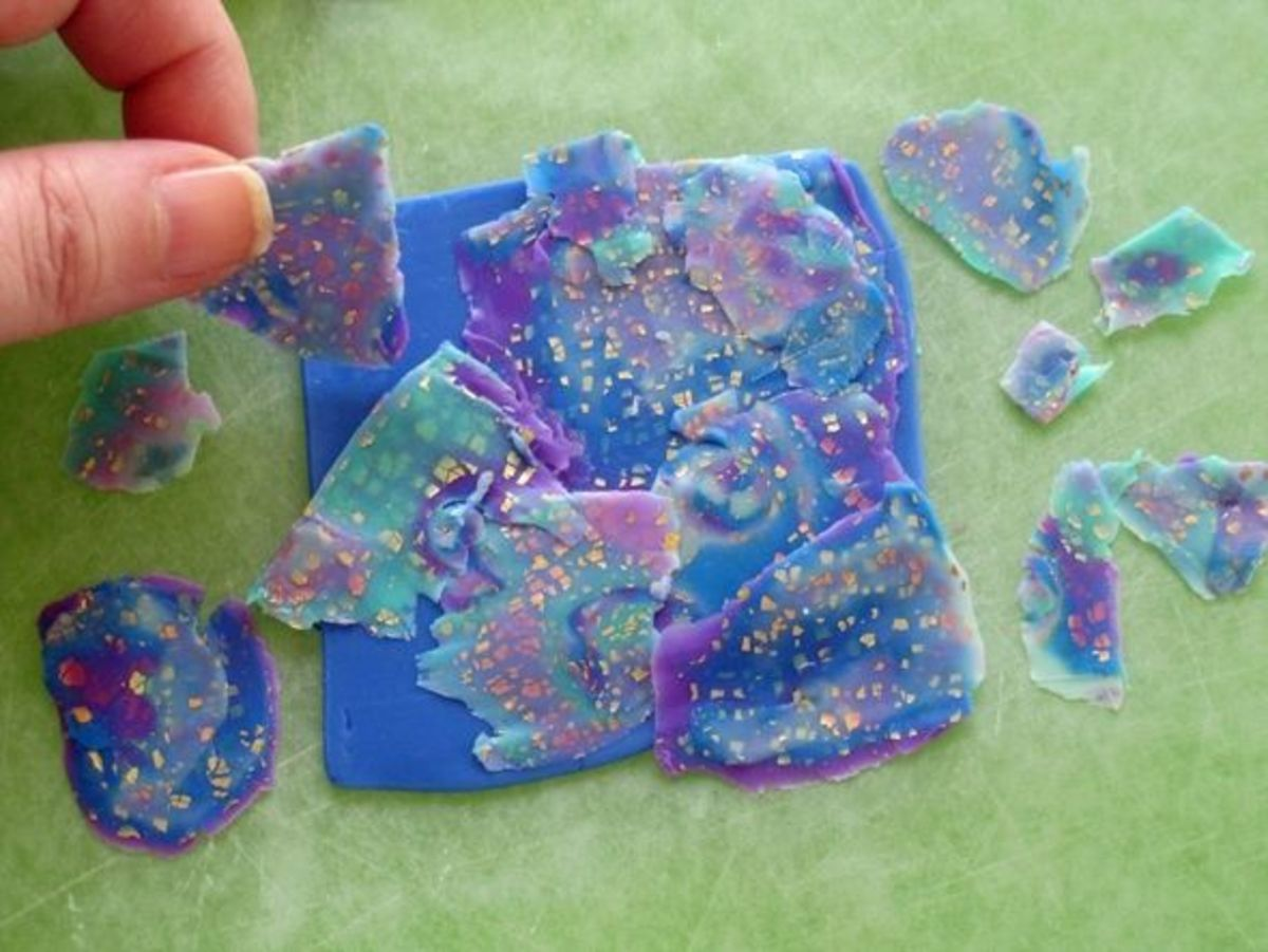 Playing around with the arrangement of shaved slices of polymer clay mokume gane that will be rolled onto the backing sheet individually to create a patterned veneer