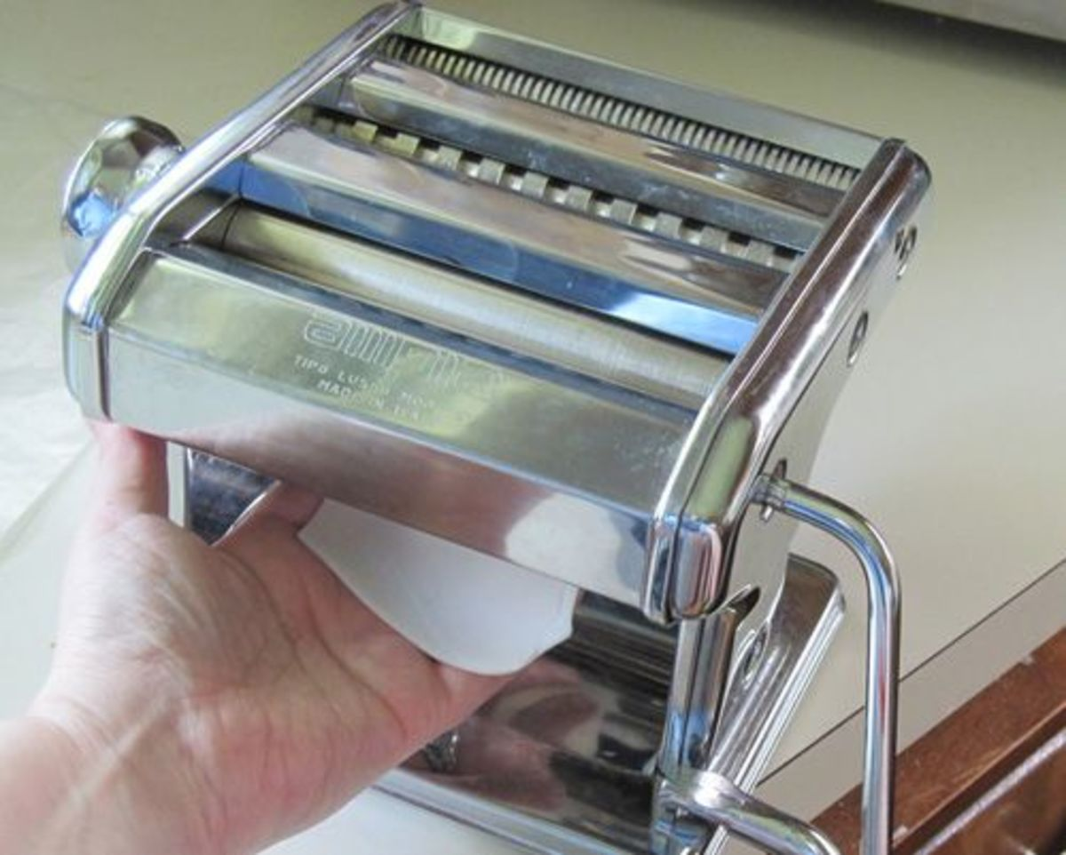 Photo: Conditioned polymer clay being rolled through a pasta machine. Credit: Margaret Schindel