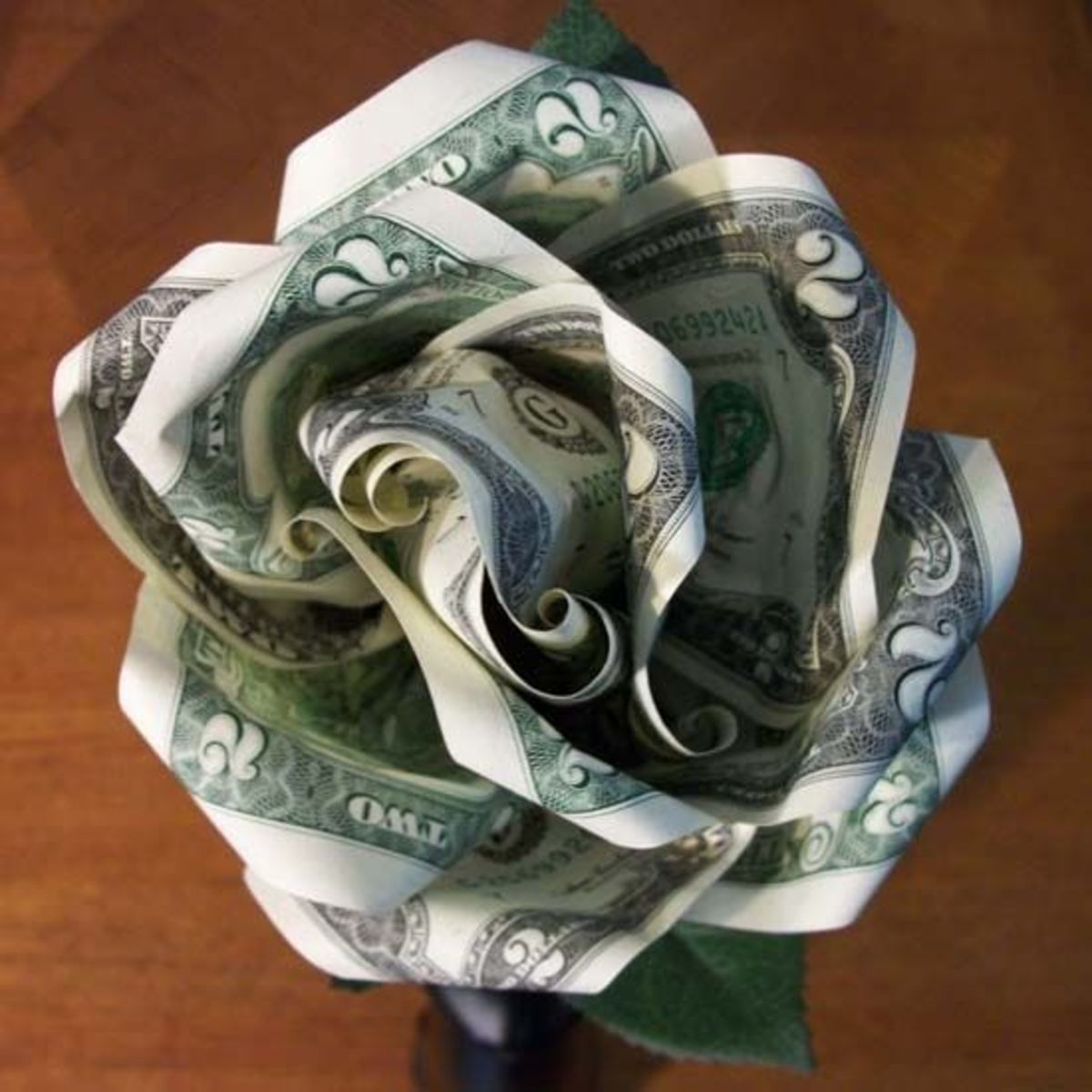 This bloom is made of two-dollar bills. I used six two-dollar bills—five became petals and the sixth became the bud in the center.