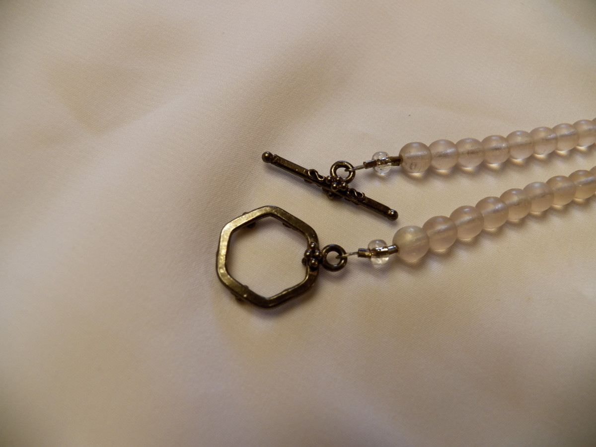 Crimp beads attach clasps on flexible wire.