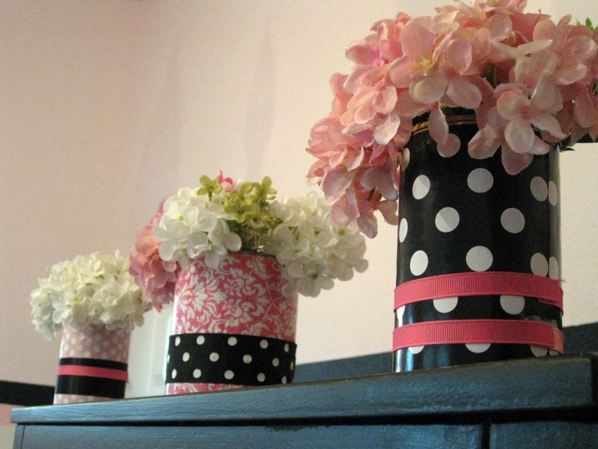 Covered can vases