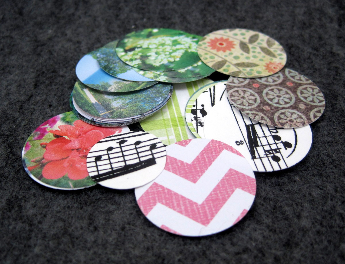 Small floral stone circles and larger circles ready to go.  I have a mix of scrapbook paper, sheet music printed on card stock, and photos printed on card stock.