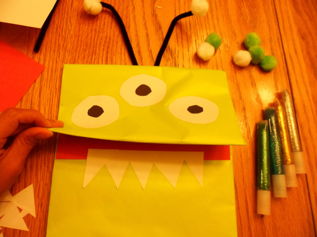 Cut out and glue teeth, inside of mouth, and hands.