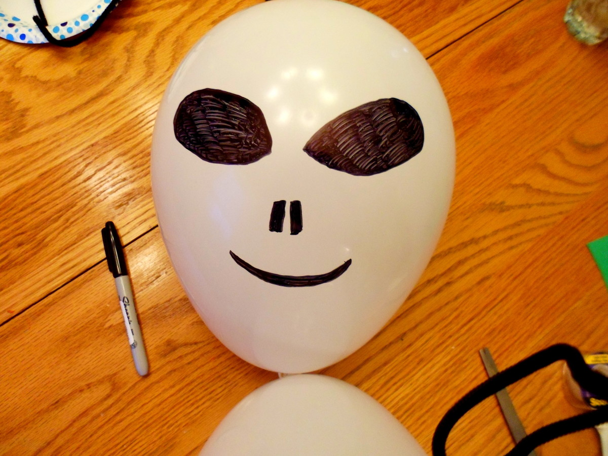 Use a permanent black marker to create the face.