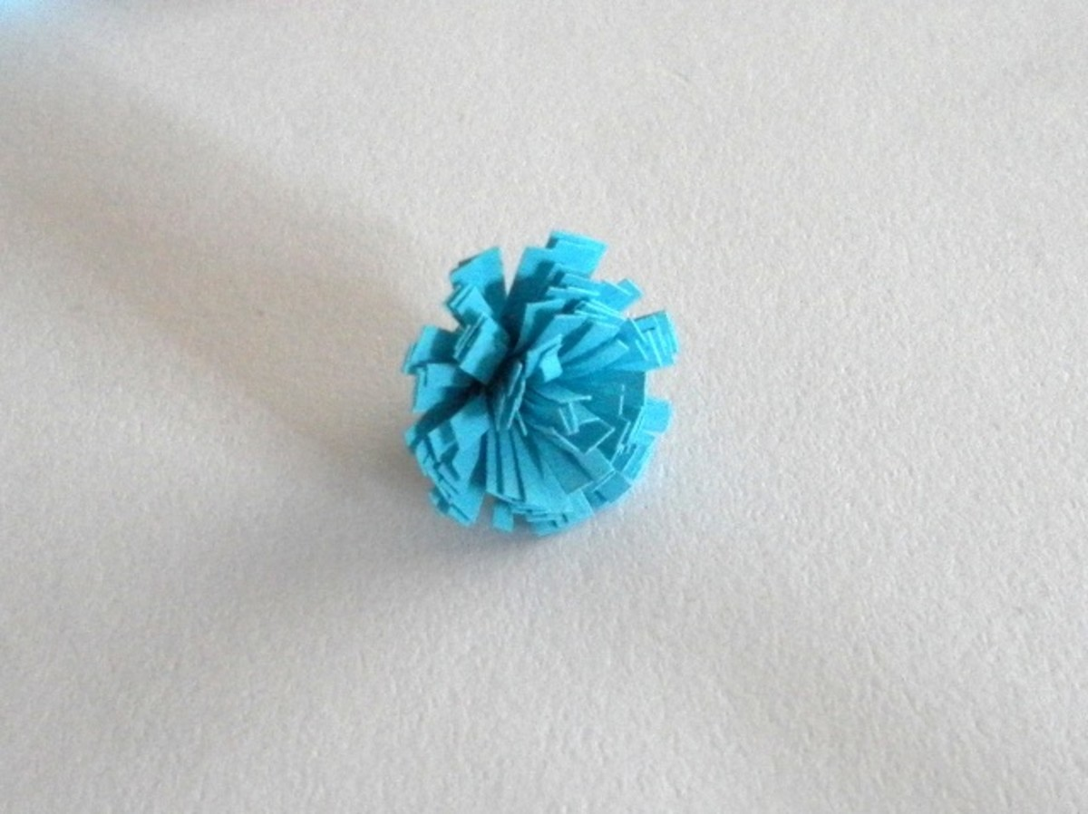 Press the fringes down to form a flower
