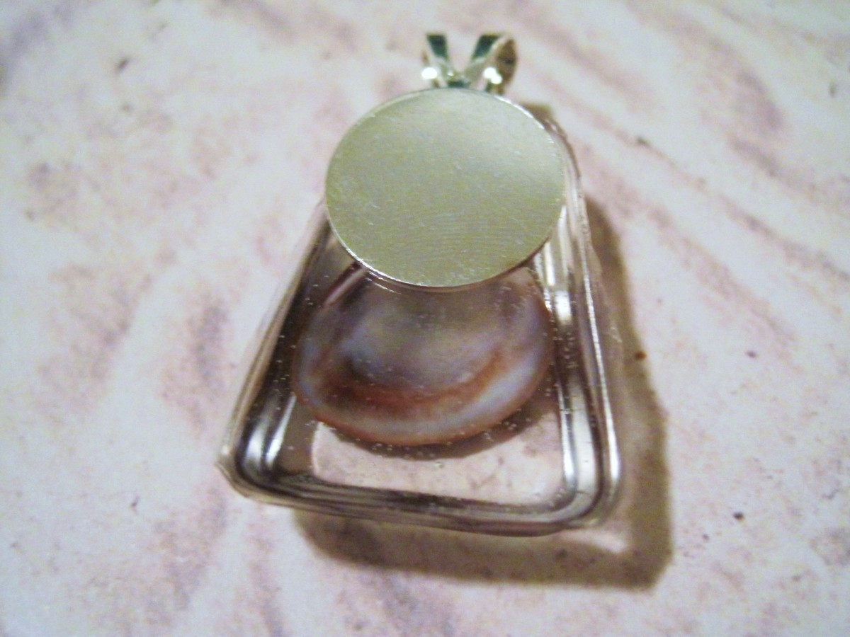 No drill? You can use a glue on bail like this one. Glue the bail to the back of the pendant with superglue.