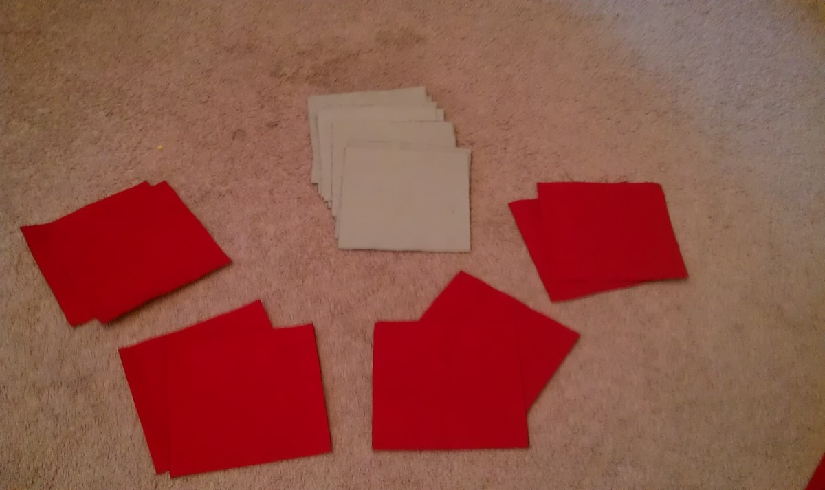 Cut out 8 squares of each color of duck cloth.