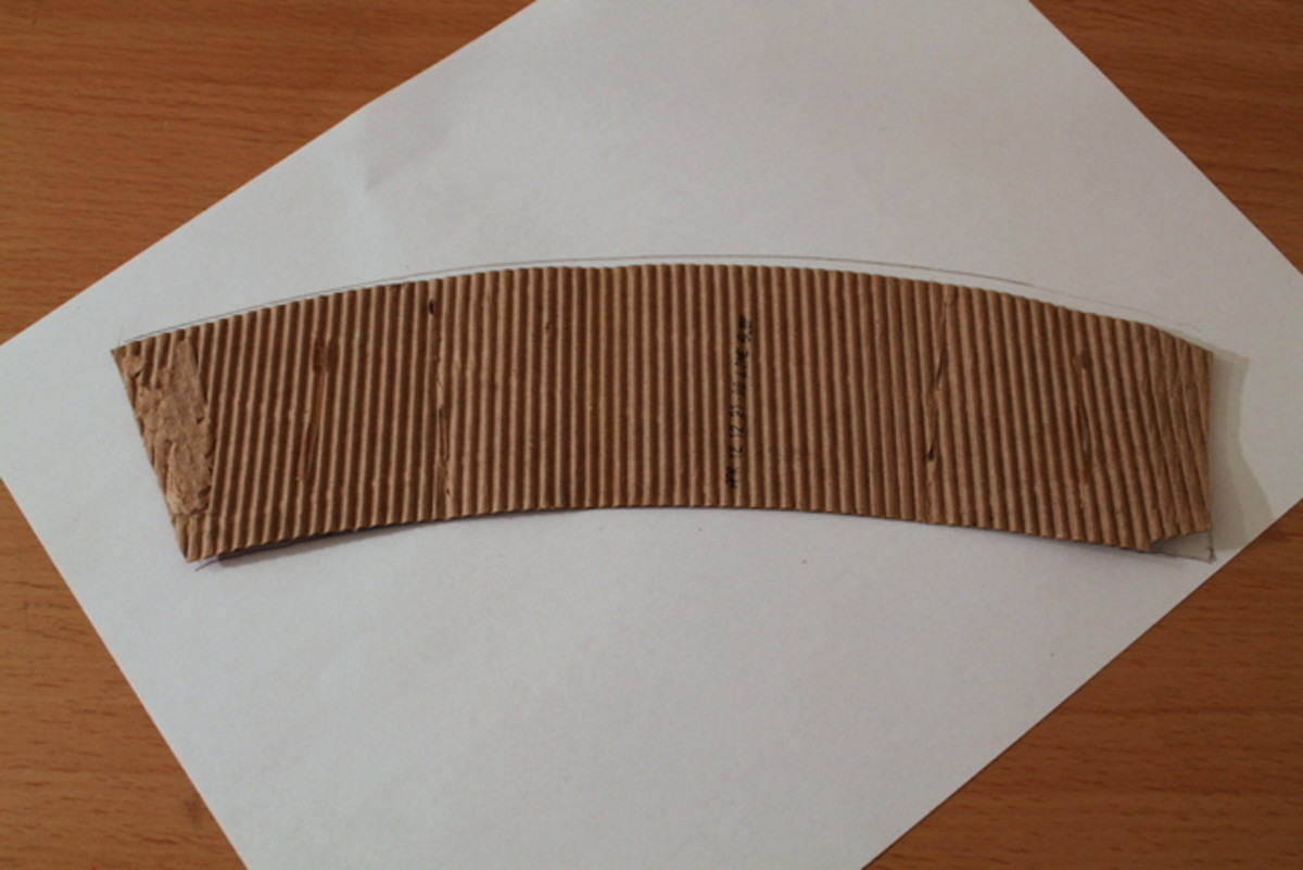 Open the cardboard sleeve and lay it flat on a sheet of paper