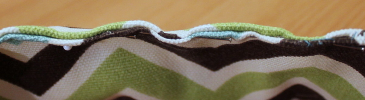 Tuck the fabric edges under and pin the gap closed