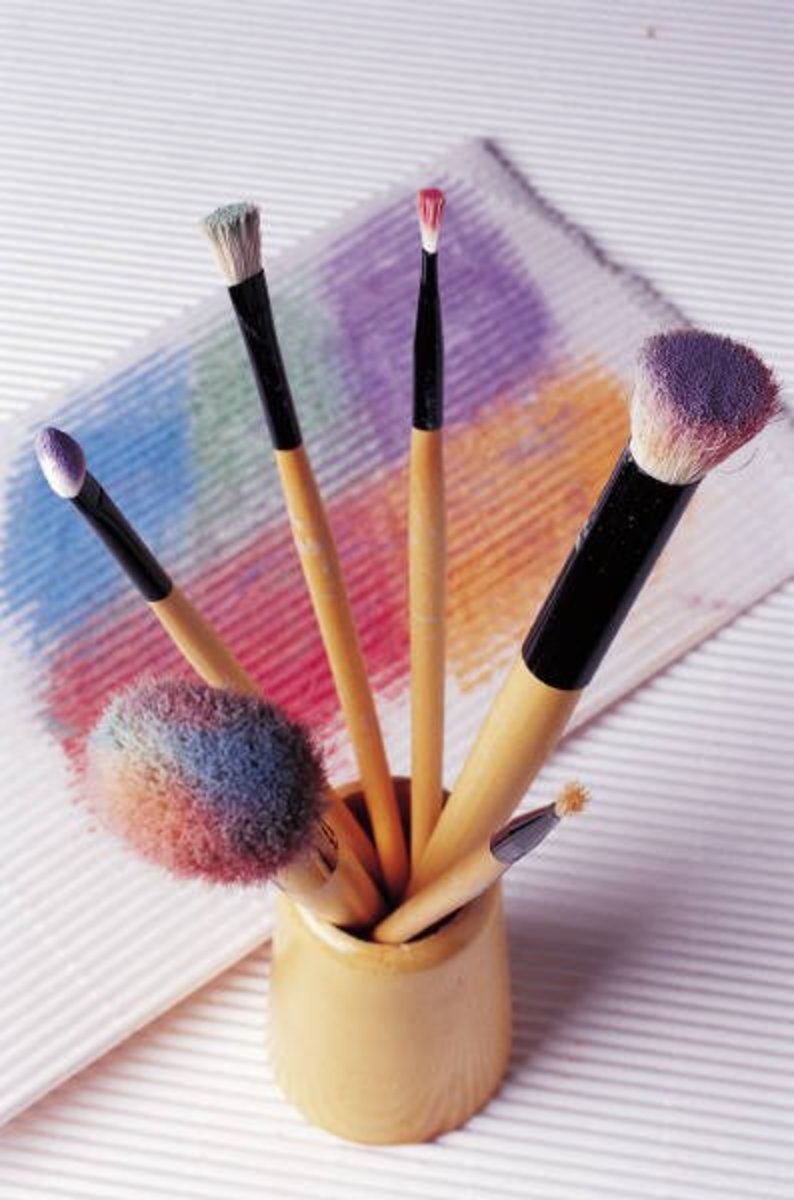 Stenciling brushes. Always blot your brush and apply the paint dabbing lightly and evenly.