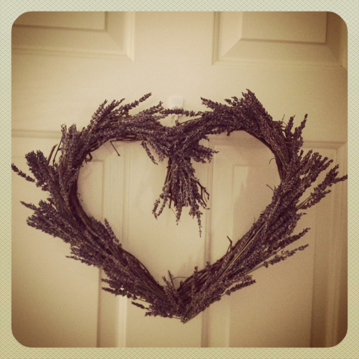 My finished lavender wreath hanging on the front door of my home.