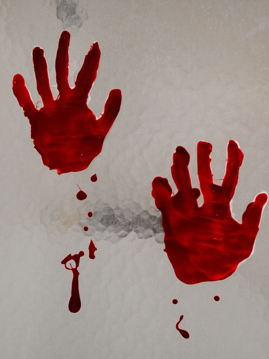 DIY bloody handprint window cling on a shower door.