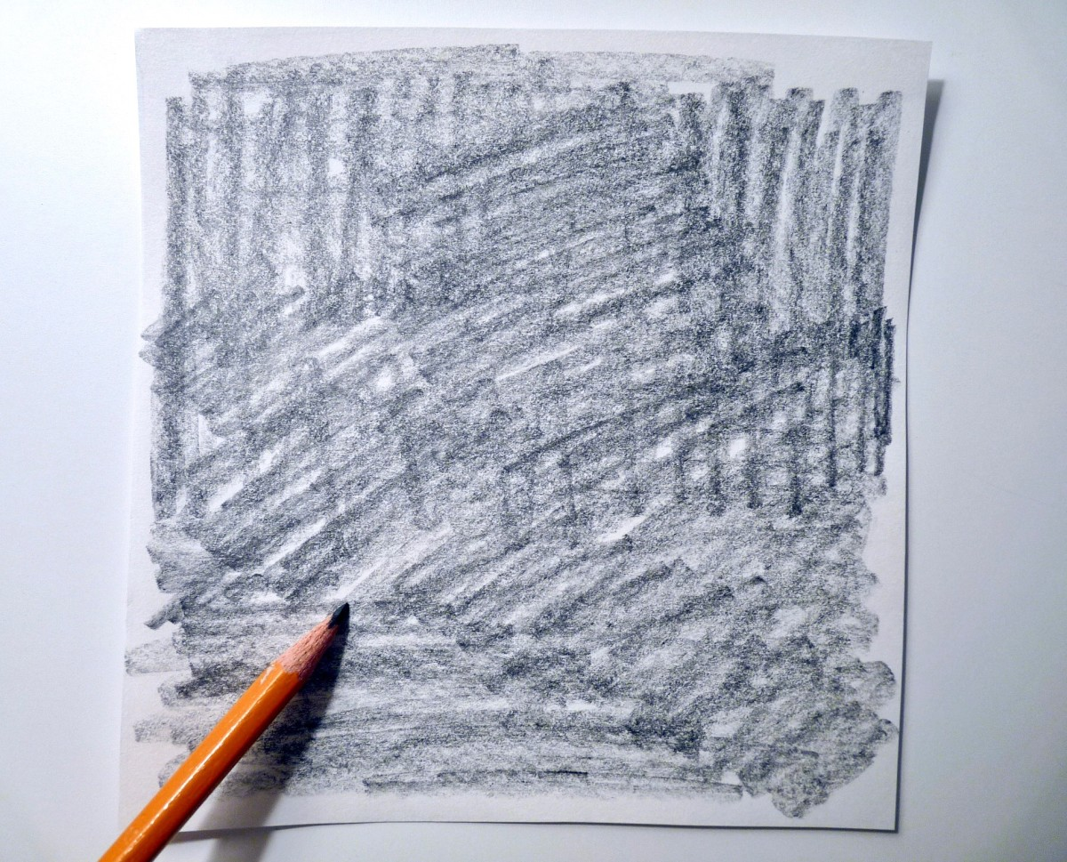 Darken the back of your sketch with the sides of your pencil.