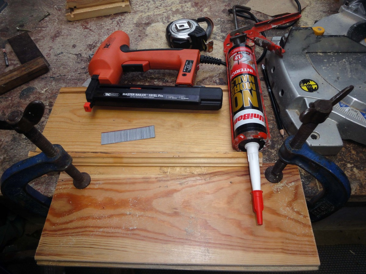 Fixing an end stop to the far edge of the wooden side panel with pins (nail gun) and glue