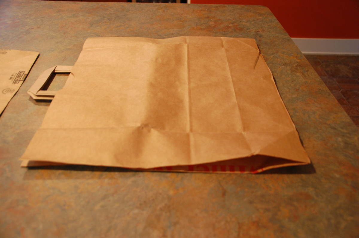 invert the paper bag inside out so the students can decorate it