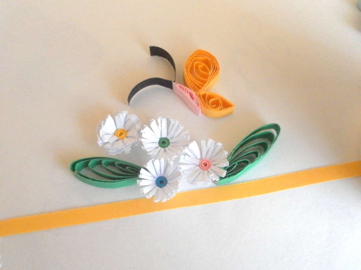 Quilled butterfly and flowers.