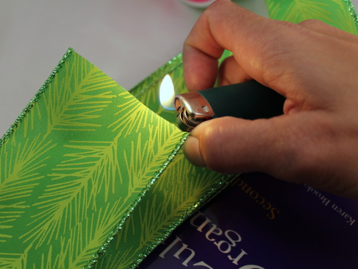 Carefully use heat to melt the ribbon's edge to prevent fraying.
