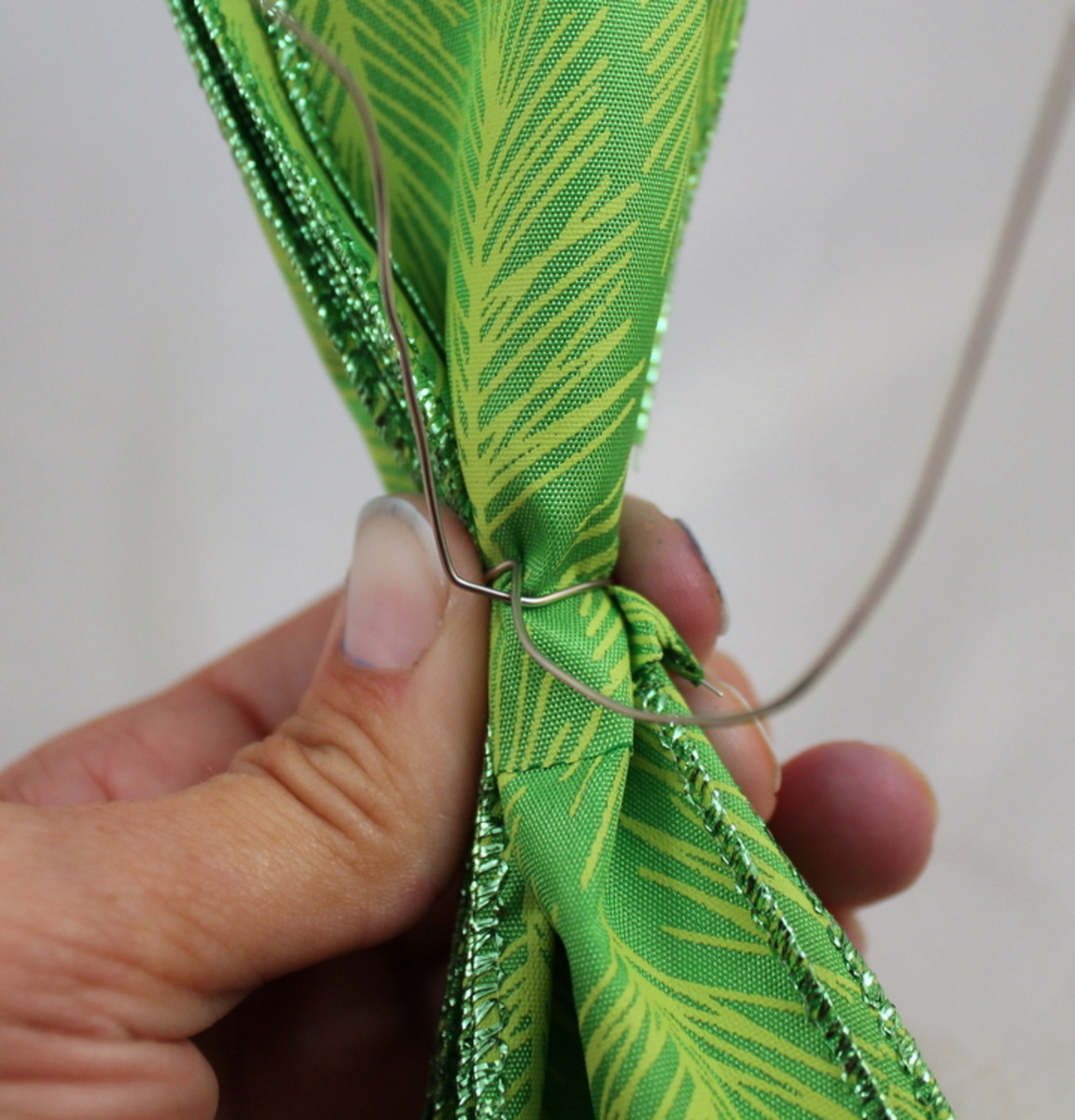 Wrap wire around the pinched middle