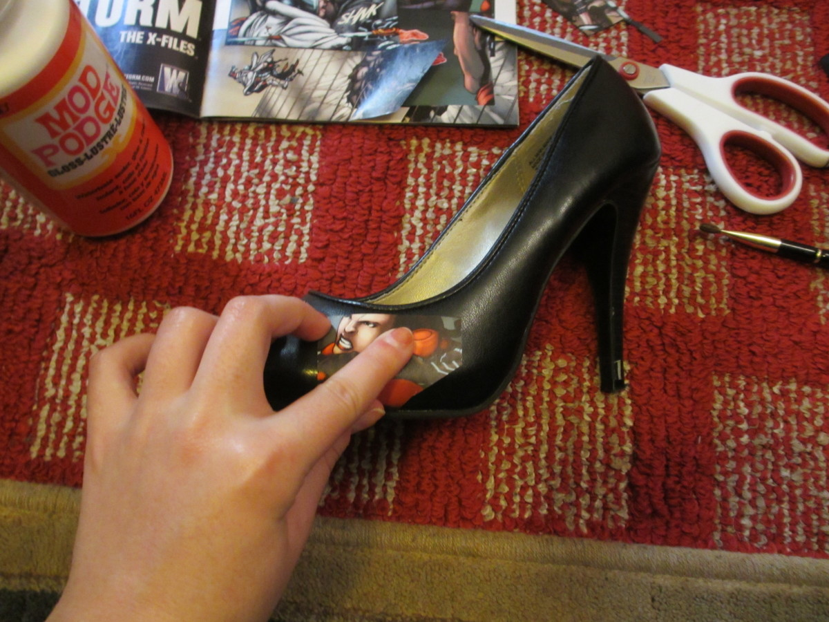 Press each piece firmly onto the surface of the shoe.