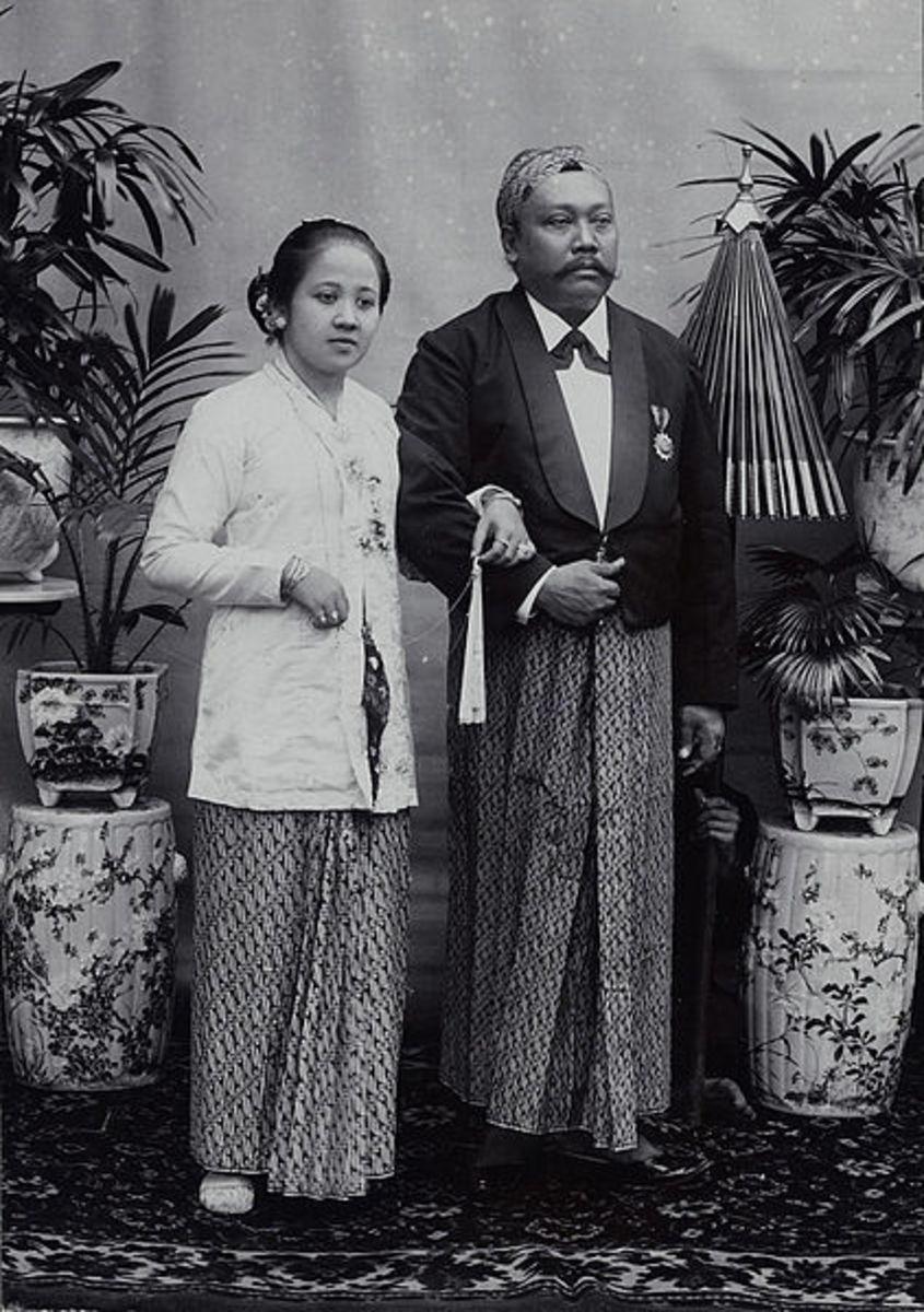 Javanese aristocrats wearing intricate batik