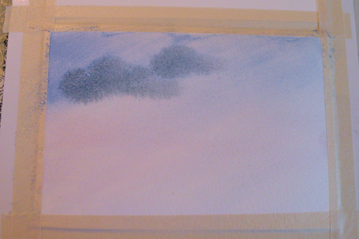 Use a #10 round brush to roughly paint in some Payne's gray clouds on the wet paper.