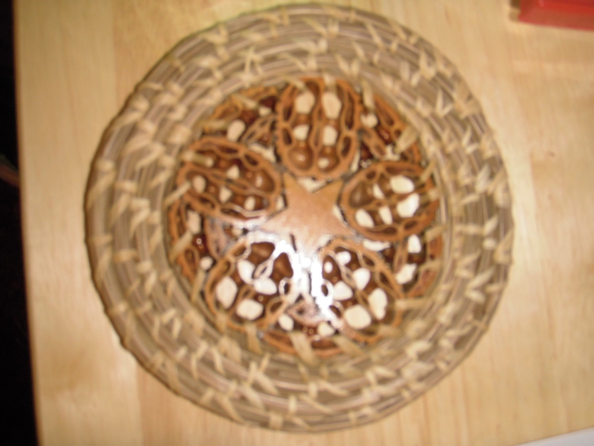 This decorative plate by J. Simpson has a wooden star surrounded by slices of walnut shell in the centre.