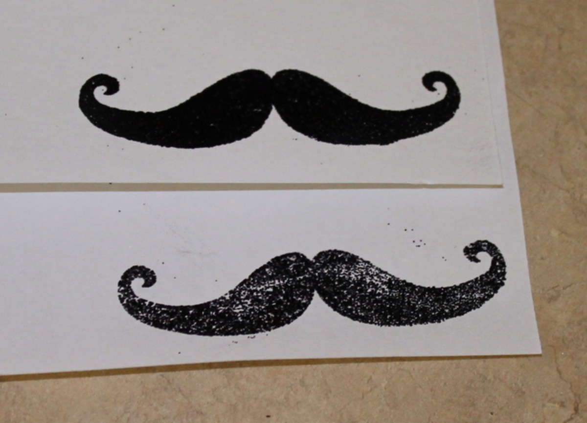 The top mustache was embossed with a heat gun, the bottom one with the stove. The heat gun works much better!