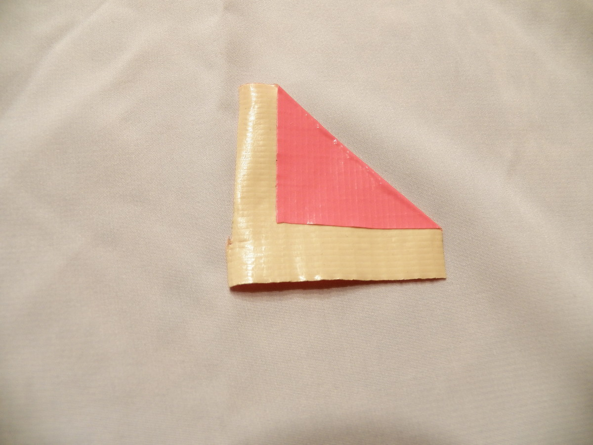Step 2: fold right side down into a triangle. leave about 1/3 to 1/2 inch of duct tape uncovered.