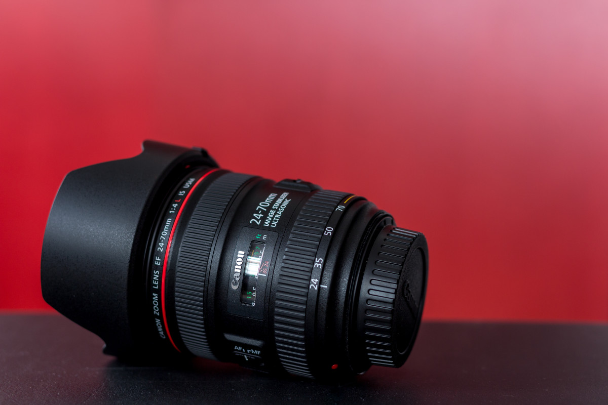 Canon EF 24-70mm f/4L IS USM lens with hood attached.