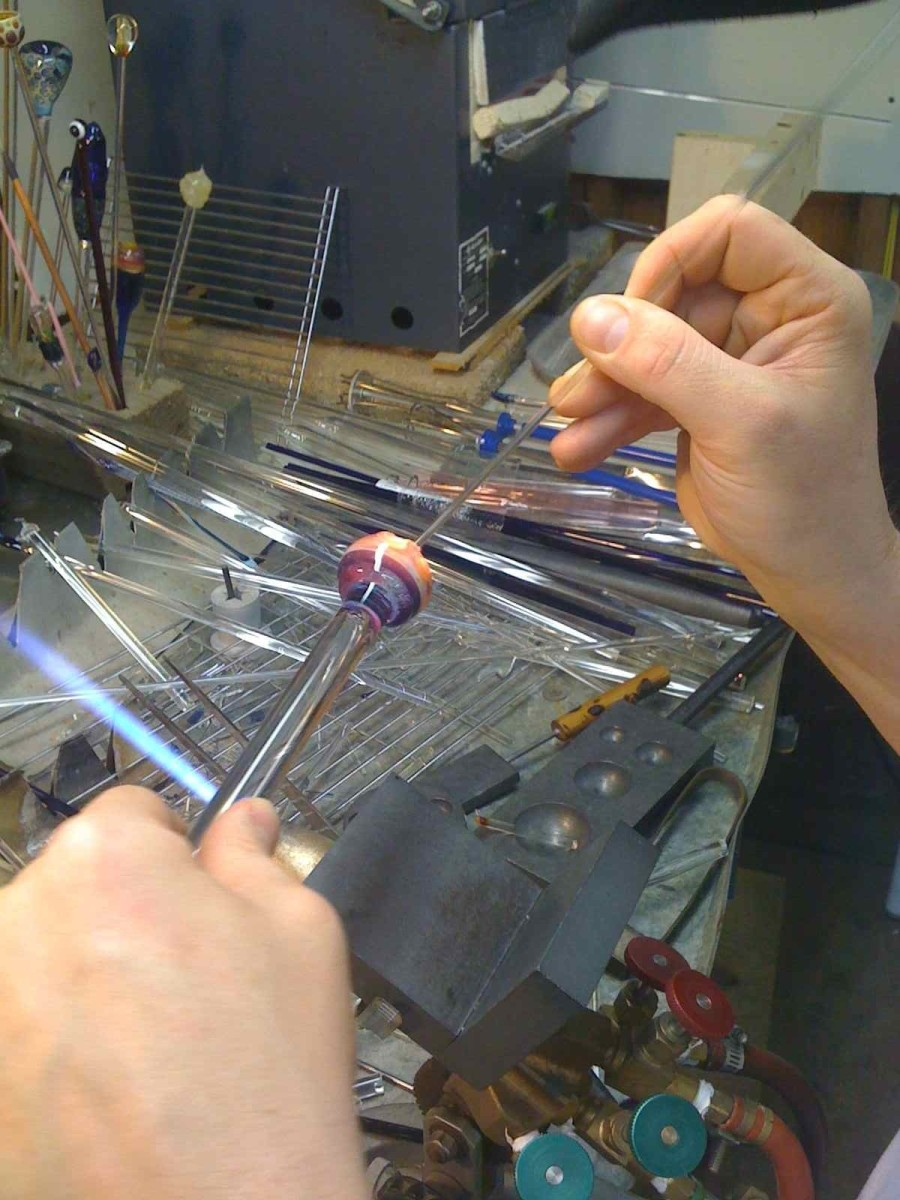 Spin the dots with a clear stick of glass for add effect.  They can also be streaked or dragged in different directions.