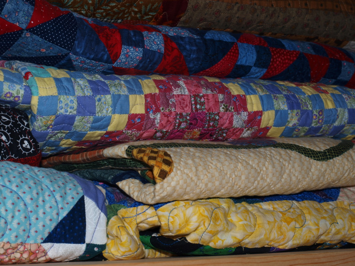 Quilts stored in a closet.