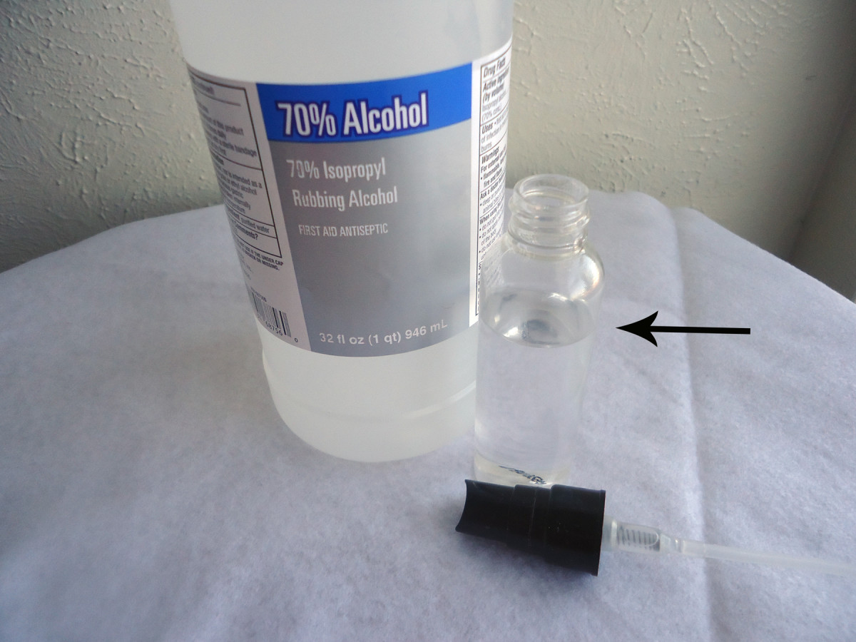 Put alcohol in small spray bottle.